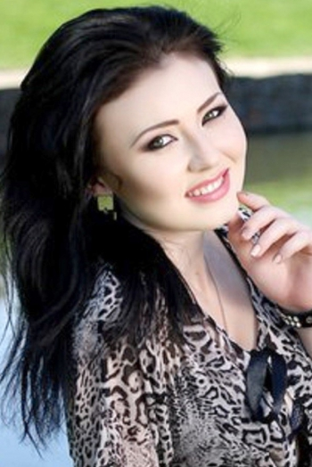 Ukrainian girl Anna,22 years old with green eyes and black hair.