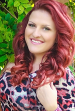 Ukrainian girl Irina,22 years old with green eyes and red hair.