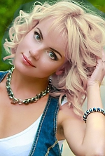 Russian girl Natalia,30 years old with green eyes and blonde hair.