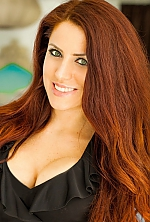 Ukrainian girl Natalia,37 years old with green eyes and red hair.
