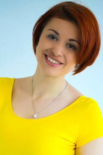 Ukrainian girl Diana,22 years old with hazel eyes and red hair.