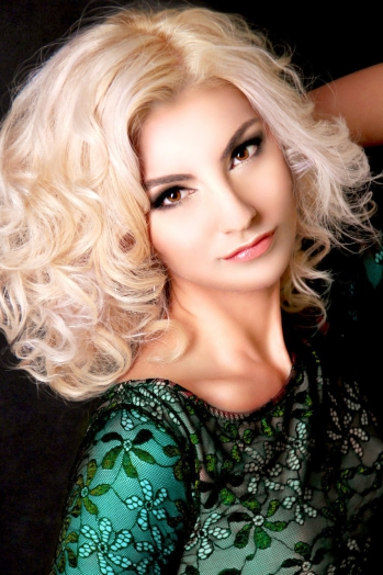 Ukrainian girl Marina,36 years old with brown eyes and blonde hair.