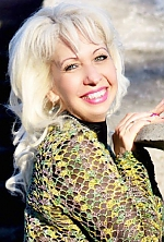 Ukrainian girl Elena,43 years old with grey eyes and blonde hair.