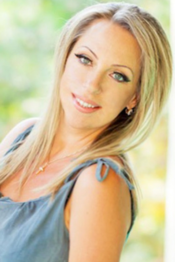Ukrainian girl Natalia,45 years old with blue eyes and blonde hair.