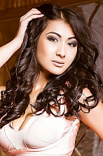 Ukrainian girl Sabina,25 years old with brown eyes and dark brown hair.