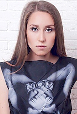 Ukrainian girl Anastasia,21 years old with green eyes and light brown hair.