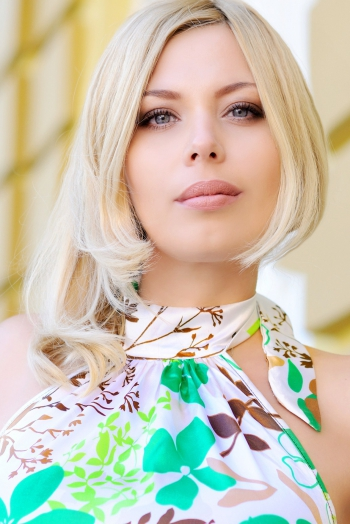 Ukrainian girl Ekaterina,36 years old with blue eyes and blonde hair.