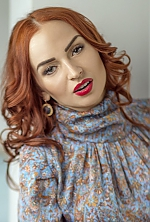 Ukrainian girl Catherine,30 years old with green eyes and auburn hair.
