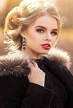 Ukrainian girl Alice,20 years old with blue eyes and blonde hair.
