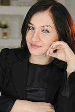 Ukrainian girl Lyudmila,26 years old with blue eyes and dark brown hair.