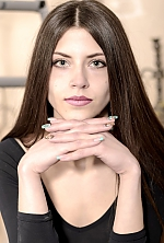 Ukrainian girl  Yana,21 years old with grey eyes and dark brown hair.