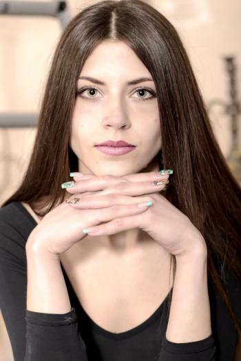 Ukrainian girl  Yana,21 years old with grey eyes and dark brown hair.