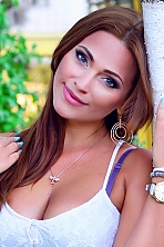 Ukrainian girl Nataliya,38 years old with green eyes and dark brown hair.
