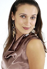 Ukrainian girl Anna,44 years old with green eyes and dark brown hair.