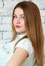 Ukrainian girl Alisa,25 years old with green eyes and light brown hair.