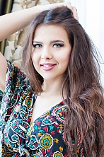 Ukrainian girl Anzhe,25 years old with green eyes and light brown hair.