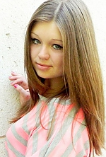 Ukrainian girl Viktoria,21 years old with green eyes and light brown hair.