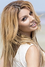 Ukrainian girl Ramila,29 years old with brown eyes and blonde hair.