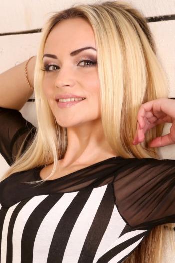 Ukrainian girl Oksana,25 years old with  eyes and  hair.