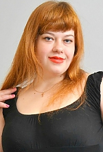 Ukrainian girl Viktoriya,22 years old with blue eyes and red hair.
