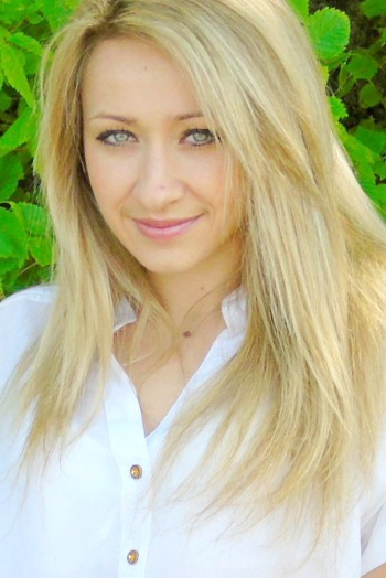 Ukrainian girl Marina,26 years old with green eyes and blonde hair.