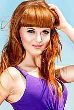 Ukrainian girl Alina,23 years old with green eyes and dark brown hair.
