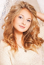 Ukrainian girl Kristina,22 years old with grey eyes and blonde hair.