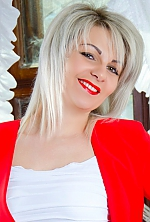 Ukrainian girl Yana,29 years old with green eyes and blonde hair.