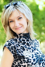 Ukrainian girl Mariya,40 years old with blue eyes and blonde hair.
