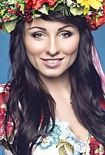 Ukrainian girl Julia,28 years old with green eyes and dark brown hair.