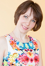 Ukrainian girl Oksana,42 years old with green eyes and light brown hair.