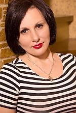 Ukrainian girl Oksana,43 years old with brown eyes and dark brown hair.
