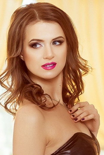 Ukrainian girl Katirina,27 years old with blue eyes and light brown hair.