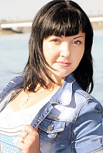 Ukrainian girl Anastasiya,35 years old with green eyes and black hair.