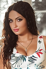 Ukrainian girl Karina,26 years old with green eyes and dark brown hair.