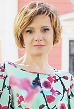 Ukrainian girl Elena,46 years old with brown eyes and light brown hair.