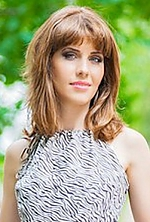 Ukrainian girl Lena,30 years old with green eyes and light brown hair.