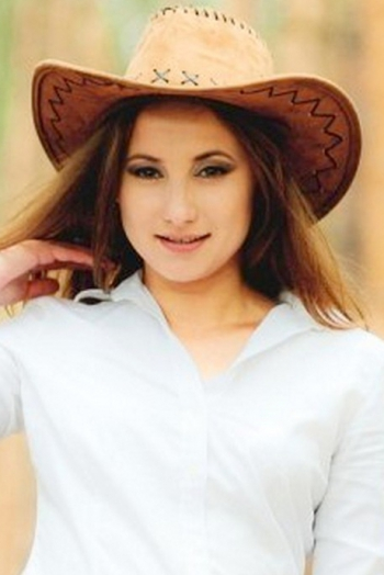Ukrainian girl Ksenia,29 years old with brown eyes and light brown hair.
