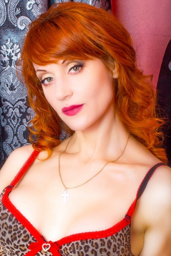 Ukrainian girl Lubov,44 years old with green eyes and red hair.