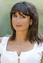 Ukrainian girl Oksana,45 years old with brown eyes and dark brown hair.