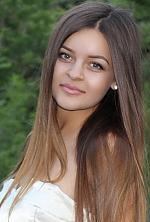 Ukrainian girl Anna,22 years old with grey eyes and dark brown hair.