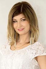 Ukrainian girl Juliya,26 years old with green eyes and light brown hair.