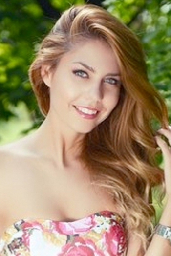 Ukrainian girl Tatiana,25 years old with green eyes and light brown hair.