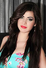 Ukrainian girl Alena ,23 years old with green eyes and dark brown hair.