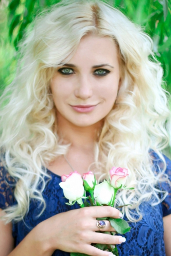 Ukrainian girl Anna,26 years old with grey eyes and blonde hair.