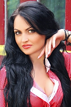 Ukrainian girl Olga,35 years old with green eyes and black hair.