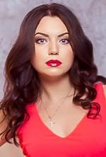 Ukrainian girl Angelina,25 years old with blue eyes and dark brown hair.