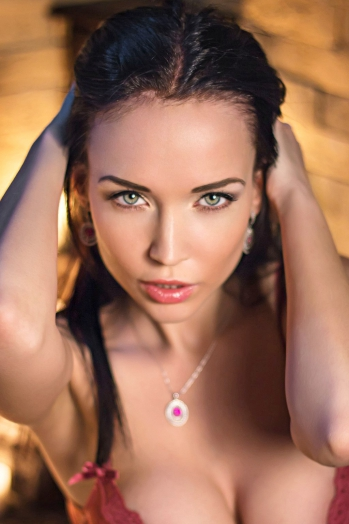 Ukrainian girl Angelina,25 years old with green eyes and black hair.