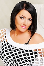 Ukrainian girl Milena,40 years old with grey eyes and black hair.