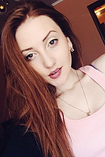 Ukrainian girl Viktoriya,23 years old with green eyes and red hair.